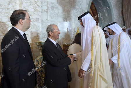 Qatar's Emir Sheikh Tamim bin Hamad al-Thani (C-R) shakes hands with interim Tunisian president Mohamed Ennaceur (2nd-L), as Prime Minister Youssef Chahed (L) stands by during the state funeral of late president Beji Caid Essebsi at the presidential palace in the eastern suburb of Carthage, Tunis, Tunisia, 27 July 2019. Essebsi, the country's first head of state elected in nationwide polls, died on 25 July at the age of 92, triggering fears of political unrest in a country seen as a rare success story following the Arab Spring uprisings.