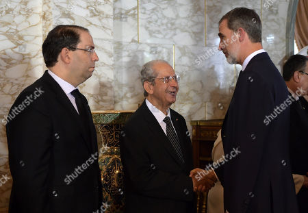 King Felipe VI of Spain (R) shakes hands with interim Tunisian president Mohamed Ennaceur (C) as Tunisian Prime Minister Youssef Chahed (L) stands by during the state funeral of late Tunisian president Beji Caid Essebsi at the presidential palace in the eastern suburb of Carthage, Tunis, Tunisia, 27 July 2019. Essebsi, the country's first head of state elected in nationwide polls, died on 25 July at the age of 92, triggering fears of political unrest in a country seen as a rare success story following the Arab Spring uprisings.