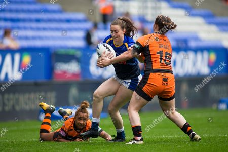 Stock Photo of Sophie Nuttall of Leeds is tackled by Olivia Grace of Castleford.