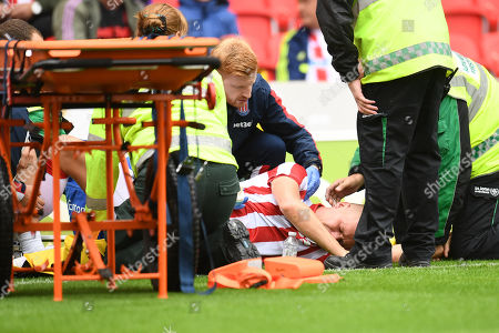 Ryan Shawcross of Stoke City receives treatment for his ankle injury.