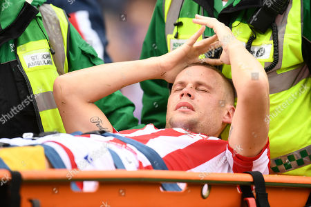 Ryan Shawcross of Stoke City leaves the field after picking up an injury.