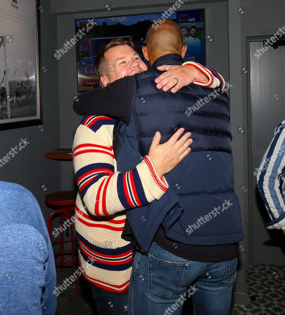 James Corden and Bobby Zamora meet up with a hug in The Flag Hospitality Suite