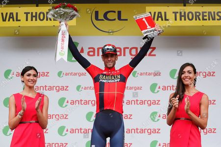 Italy's Vincenzo Nibali (C) of the Bahrain Merida team celebrates on the podium after winning the 20th stage of the 106th edition of the Tour de France cycling race over 59.5km between Albertville and Val Thorens, France, 27 July 2019.
