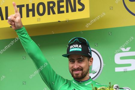 Slovakia's Peter Sagan wearing the best sprinter's green jersey celebrates on the podium after the twentieth stage of the Tour de France cycling race over 59,5 kilometers (36,97 miles) with start in Albertville and finish in Val Thorens, France