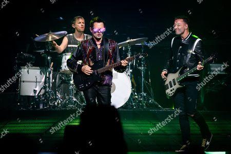 Muse - Dominic Howard, Matt Bellamy and Chris Wolstenholme