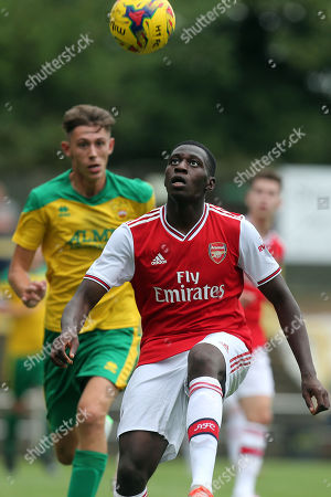 Stock Picture of Max Ryan of Hitchin Town and Mazeed Ogungbo of Arsenal under-23s during Hitchin Town vs Arsenal, Friendly Match Football at Top Field on 27th July 2019