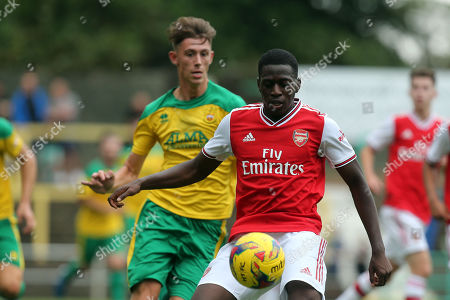 Max Ryan of Hitchin Town and Mazeed Ogungbo of Arsenal under-23s during Hitchin Town vs Arsenal, Friendly Match Football at Top Field on 27th July 2019