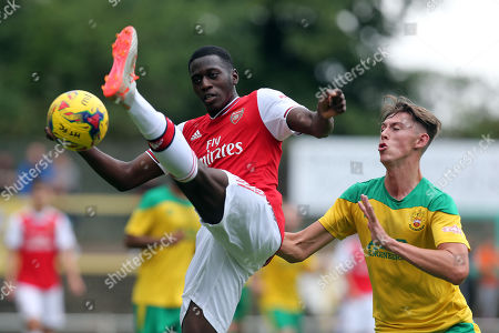 Stock Image of Max Ryan of Hitchin Town and Mazeed Ogungbo of Arsenal under-23s during Hitchin Town vs Arsenal, Friendly Match Football at Top Field on 27th July 2019