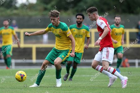 Max Ryan of Hitchin Town and Stan Flaherty of Arsenal under-23s during Hitchin Town vs Arsenal, Friendly Match Football at Top Field on 27th July 2019