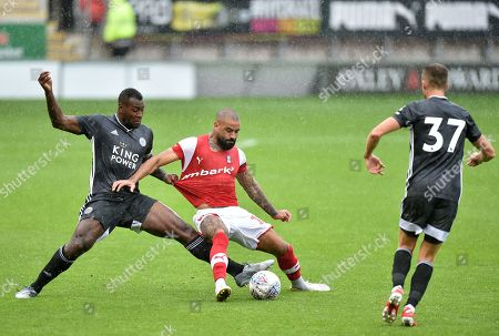 Wes Morgan of Leicester City and Kyle Vassell of Rotherham United