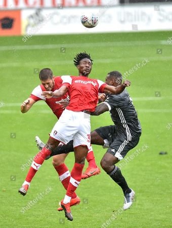 Akeem Hinds of Rotherham United and Jamie Proctor challenge Wes Morgan of Leicester City