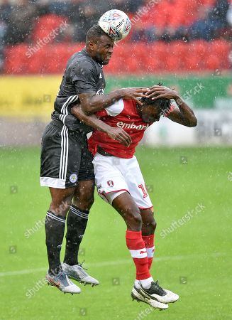 Wes Morgan of Leicester City and Freddie Ladapo of Rotherham United