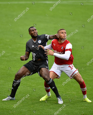 Wes Morgan of Leicester City and Carlton Morris of Rotherham United