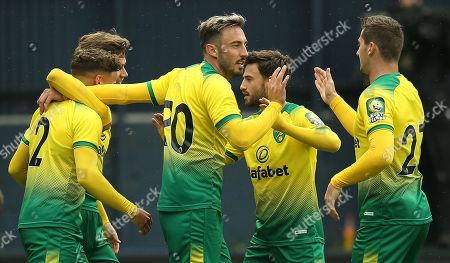 Josip Drmic of Norwich City celebrates scoring his sides second goal with team-mates