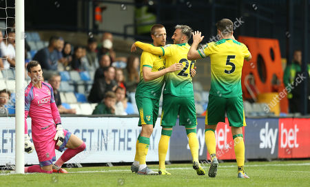Marco Stiepermann of Norwich City celebrates scoring the opening goal with team-mate   Josip Drmic of Norwich City  while  Simon Sluga of Luton Town looks dejected