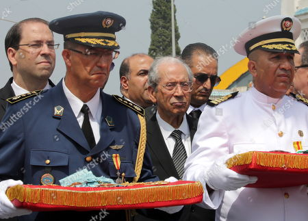 Tunisian Prime Minister Youssef Chahed (L)  and interim Tunisian president Mohamed Ennaceur (4-L) take part in the procession accompanying the coffin of late Tunisian President Beji Caid Essebsi during his state funeral in Tunis, Tunisia, 27 July 2019. Essebsi, who led the country's transition to democracy following the Arab Spring protests in 2011, died on 25 July at the age of 92.
