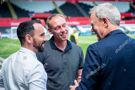 Stock Photo of Swansea City v Atalanta, Pre Season Friendly -( L-R ) Leon Britton, Steve Cooper, Manager of Swansea City and Chairman Trevor Birch chat ahead of Kick off.