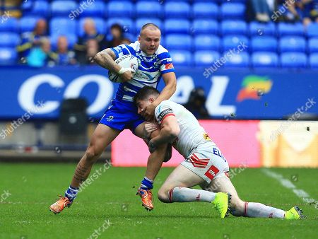 Stock Image of Ben Johnston of Halifax RLFC is tackled by Mark Percival of St Helens