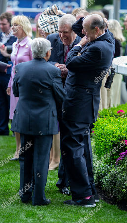 A laugh and a joke, Prince Andrew with former champion jockey Willie Carson and Lord Nicholas Soames after the presentation of the King George Gold Cup.