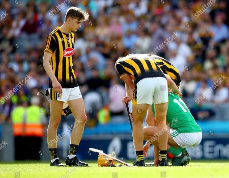 Limerick vs Kilkenny. Kilkenny's Billy Reid, Padraic Moylan and William Halpin console Cathal O'Neill of Limerick