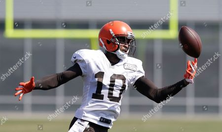 Cleveland Browns wide receiver Jaelen Strong reaches to catch a pass during practice at the NFL football team's training camp facility, in Berea, Ohio