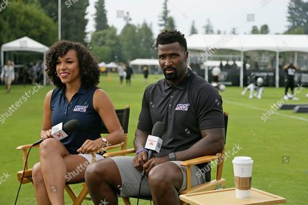 NFL network analyst James Jones with reporter MJ Acosta, left, during the Oakland Raiders NFL football training camp, in Napa, Calif