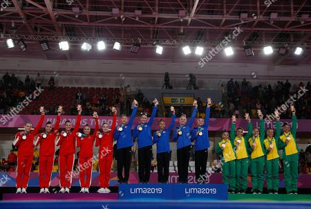 The medalists in the women's gymnastics team final hold up their medals after the end of competition in the women's gymnastics team final at the Pan American Games in Lima, Peru, . From left, are Canada silver medal winners Elsabeth Ann Black, Brooklyn Chloe Moors, Shallon Jade Olsen, Victoria Kayen Woo, and Isabela Onyshko; U.S. gold medal winners Kara Eaker, Aleah Finnegan, Morgan Hurd, Riley McCusker, and Leanne Wong, and Brazil bronze medalists Flavia Saraiva, Jade Barbosa, Thais Dos Santos, Lorrane Oliveira, and Carolyne Pedro