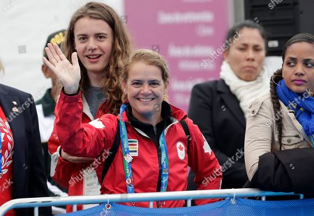 Canada's Gov. General Julie Payette waves to the crowd during the men's triathlon at the Pan American Games in Lima, Peru