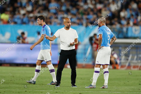 Josep Pep Guardiola head coach and Kyle Walker of Manchester City