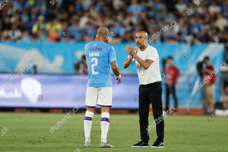 Stock Photo of Kyle Walker and Josep Pep Guardiola head coach of Manchester City