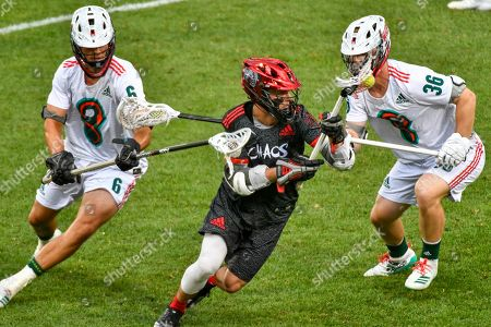 Chaos' Connor Fields splits Whipsnakes defenders' Bryce Young (6) and Tim Muller (36) during a Premier Lacrosse League game on in Commerce City, Colo