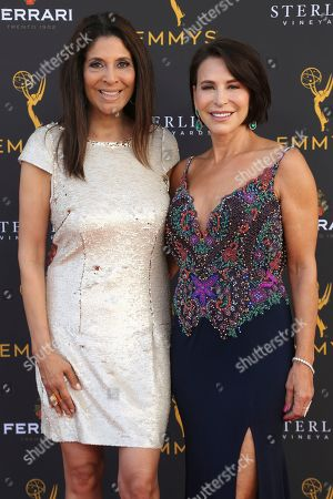 Christine Devine, Giselle Fern'ndez. Christine Devine, left, and Giselle Fernández arrive at the 71st Los Angeles Area Emmy Awards at the Saban Media Center at the Television Academy's North Hollywood, Calif. headquarters on