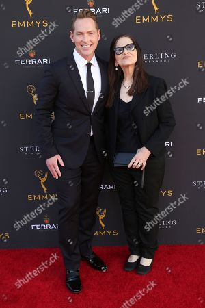 Matt Johnson, left, and guest arrive at the 71st Los Angeles Area Emmy Awards at the Saban Media Center at the Television Academy's North Hollywood, Calif. headquarters on