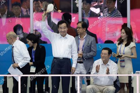 South Koream Prime Minister Lee Nak Yeon waves to the crowd during the final night of swimming at the World Swimming Championships in Gwangju, South Korea