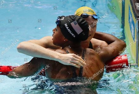 United States' Simone Manuel, bottom, is congratulated by Australia's Cate Campbell safter winning the women's 50m freestyle final at the World Swimming Championships in Gwangju, South Korea