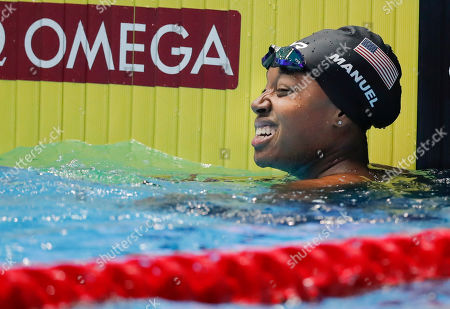 United States' Simone Manuel reacts after winning the women's 50m freestyle final at the World Swimming Championships in Gwangju, South Korea