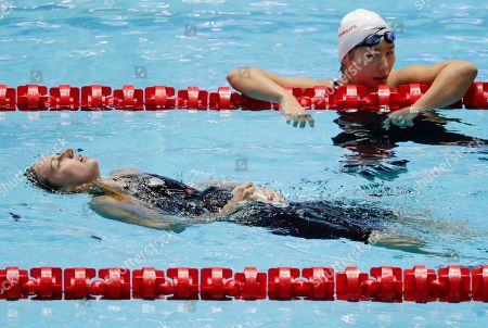 Stock Image of Hungary's Katinka Hosszu, left, reacts after winning the women's 400m individual medley final as China's Ye Shiwen looks on at the World Swimming Championships in Gwangju, South Korea