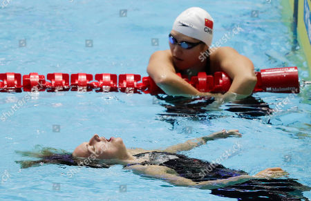 Hungary's Katinka Hosszu, left, reacts after winning the women's 400m individual medley final as China's Ye Shiwen looks on at the World Swimming Championships in Gwangju, South Korea