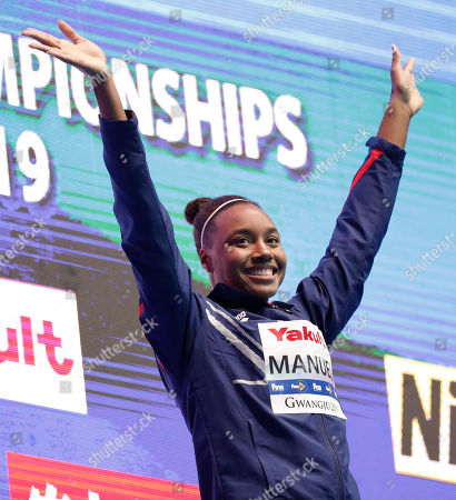 Gold medalist United States' Simone Manuel waves as she steps on the podium to receive her medal following the women's 50m freestyle final at the World Swimming Championships in Gwangju, South Korea