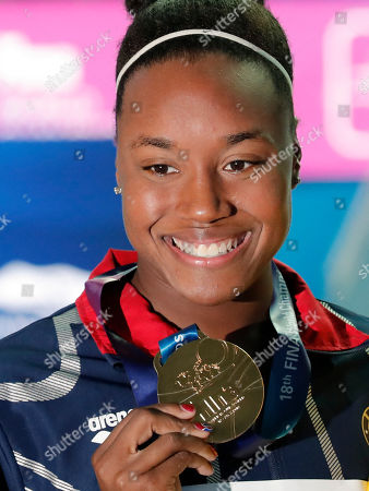 Gold medalist United States' Simone Manuel poses with her medal following the women's 50m freestyle final at the World Swimming Championships in Gwangju, South Korea