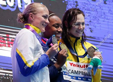 Gold medalist United States' Simone Manuel, centre, stands with silver medalist Sweden's Sarah Sjostrom, left, and bronze medalist Australia's Cate Campbell following the women's 50m freestyle final at the World Swimming Championships in Gwangju, South Korea