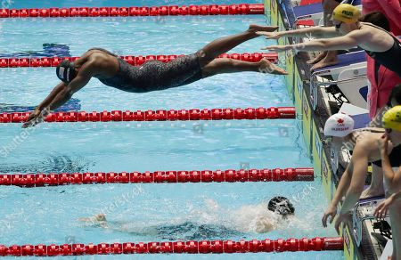 United States' Simone Manuel dives in for the final leg of the women's 4x100m medley relay final at the World Swimming Championships in Gwangju, South Korea