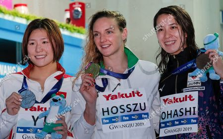 Stock Picture of Gold medalist Hungary's Katinka Hosszu, centre, stands with silver medalist China's Ye Shiwen, left, and bronze medalist Japan's Yui Ohashi following the women's 400m individual medley final at the World Swimming Championships in Gwangju, South Korea