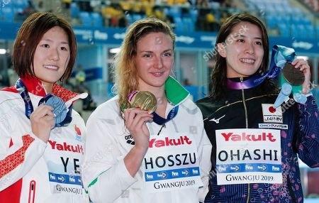 Stock Photo of Gold Medalist Hungary's Katinka Hosszu, centre, stands with silver medalist China's Ye Shiwen, left, and bronze medalist Japan's Yui Ohashi following the women's 400m individual medley final at the World Swimming Championships in Gwangju, South Korea