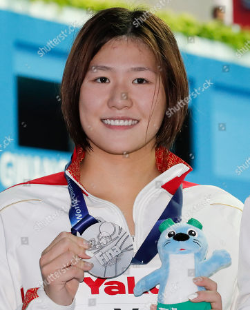 Silver medalist China's Ye Shiwen poses with her medal following the women's 400m individual medley final at the World Swimming Championships in Gwangju, South Korea