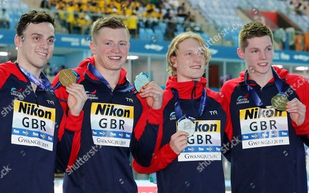 Stock Image of Britain's men's 4x100m medley relay team, from left, Luke Greenbank, Adam Peaty, James Guy and Duncan Scott pose with their gold medals at the World Swimming Championships in Gwangju, South Korea