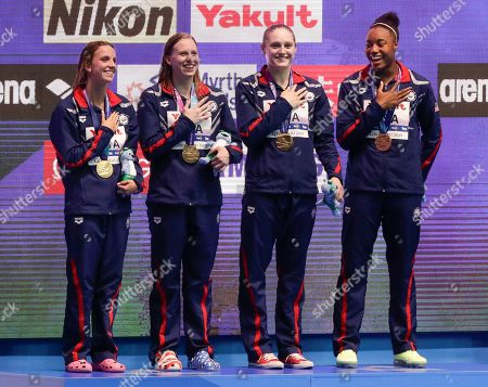The United States women's 4x100m medley relay team, from left, Regan Smith, Lilly King, Kelsi Dahlia and Simone Manuel stand on the podium after receiving their gold medals at the World Swimming Championships in Gwangju, South Korea