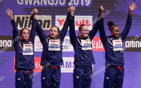 The United States women's 4x100m medley relay team, from left, Regan Smith, Lilly King, Kelsi Dahlia and Simone Manuel wave as they stand on the podium to receive their gold medals at the World Swimming Championships in Gwangju, South Korea