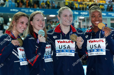 The United States women's 4x100m medley relay team, from left, Regan Smith, Lilly King, Kelsi Dahlia and Simone Manuel pose with their gold medals at the World Swimming Championships in Gwangju, South Korea