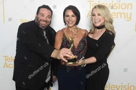 """Seth Katz, Giselle Fernandez, Stacy Strazis. EXCLUSIVE - Seth Katz, from left, Giselle Fernandez, and Stacy Strazis, from The Spectrum News 1 Production Team, winners of the Emmy for informational series (more than 50% remote) for """"LA Stories with Giselle Fernandez"""", pose for a portrait at the 71st Los Angeles Area Emmy Awards at the Saban Media Center at Television Academy's North Hollywood, Calif. headquarters on"""